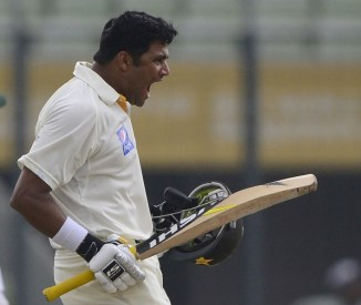 Ali exults upon bringing up his maiden double century