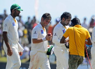 Shah (centre) finished with career-best figures of 7-76 off 30.1 overs