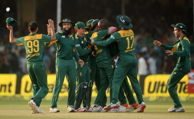 Rabada is mobbed by his team-mates after leading South Africa to victory
