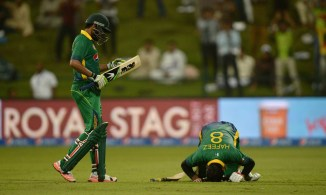 Hafeez (right) celebrates after scoring his 11th ODI century