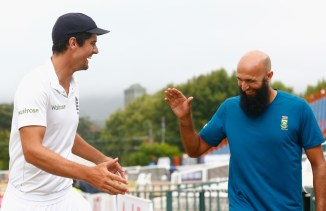Cook (left) and South Africa skipper Hashim Amla (right) are all smiles after the match ended as a draw