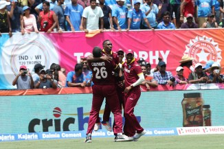 Bravo celebrates after dismissing Dhoni on the final ball of the match