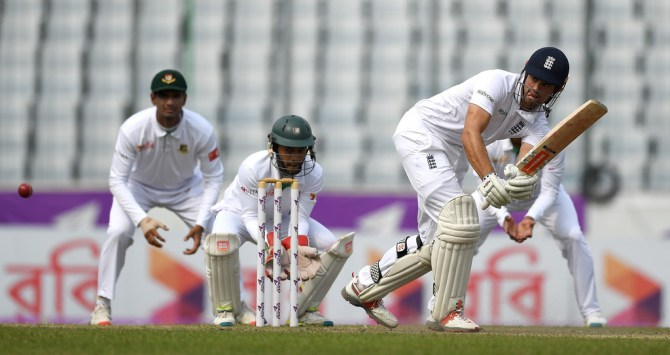 Cook made his 52nd Test fifty
