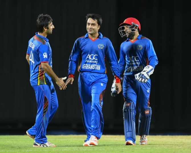 Rashid Khan five wickets Afghanistan Zimbabwe 3rd ODI Sharjah cricket