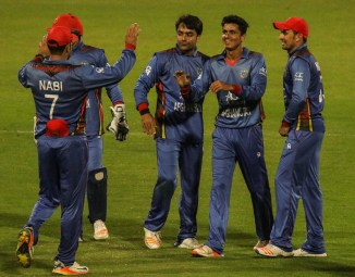Mujeeb Ur Rahman five wickets Afghanistan Zimbabwe 5th ODI Sharjah cricket