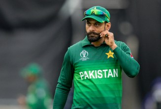 Mohammad Hafeez banned from bowling in competitions organised by the England and Wales Cricket Board ECB after his bowling action was found to be illegal Pakistan cricket