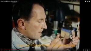 Peter Cushing painting his miniatures.