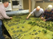 Richard Clark (left) and Chris Atkin (centre) command the Austrians at Swiepwald, whilst DZ decides how much of a mess they are in as they enter the Swiepwald during our 2015 game. The huge Austrian column flanking my position can be seen left of centre. Photo by Henry Hyde.