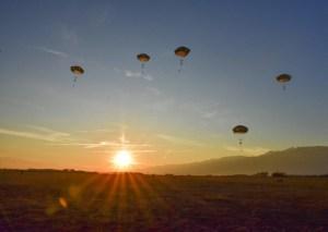 Parachute drop at dawn.