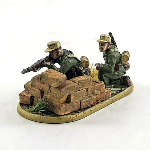 Afrika Korps sniper behind wall.