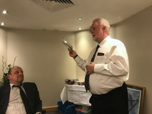 Me acting as charity auctioneer as Sid sees his chances of a bargain fading.