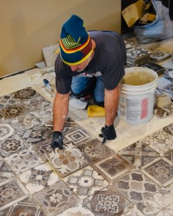 mexican tiles getting placed on floor during remodel of The Battleground Mexican restaurant and bar in Kent Ohio