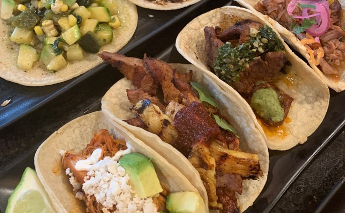 tacos plated showing steak, pork, fish, vegetarian, and vegan gourmet tacos at The Battleground in Kent Ohio