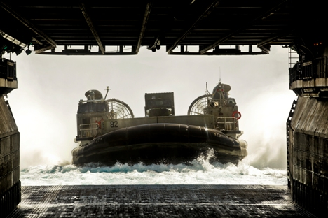 A Marine Corps landing craft air-cushioned, or LCAC, enters the well deck of the amphibious assault ship Bonhomme Richard on July 6 during the joint Rim of the Pacific military exercises off the coast of Hawaii. (Lance Cpl. Orlando Perez/Marine Corps)