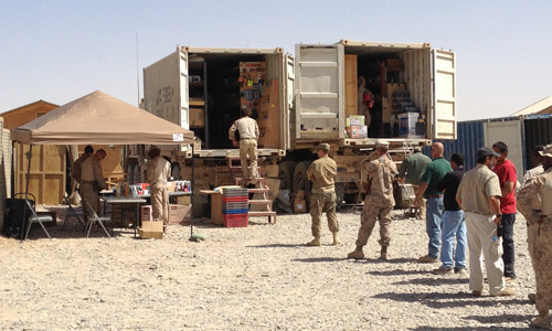Marines gather around a mobile PX store that arrived at Combat Outpost Payne on Thursday. (Colin Kelly photo)
