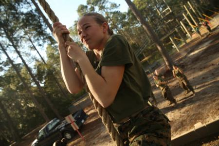 Rct. Dana Deline, Platoon 4013, Papa Company, 4th Recruit Training Battalion, pulls herself up a Confidence Course obstacle Feb. 19, 2014, on Parris Island, S.C. (Photo by Cpl. Caitlin Brink/Marine Corps)