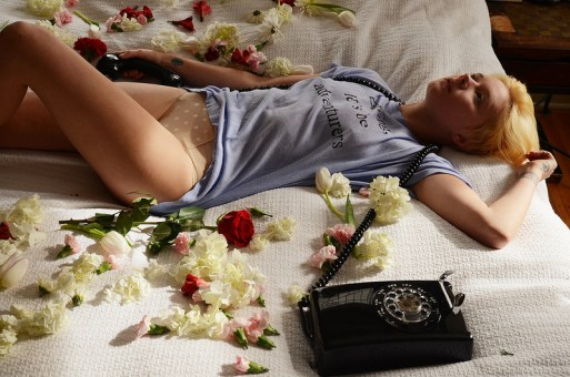 Girl lying in bed after breakup