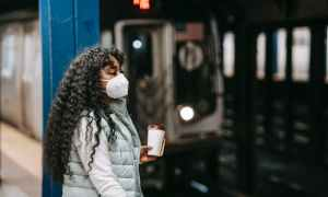 Black woman standing on metro platform