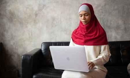 Arabian woman working on laptop