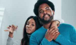 Black couple holding key