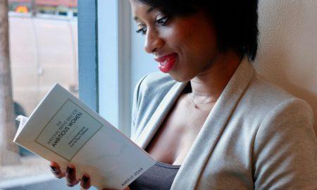 marielle legair holding book