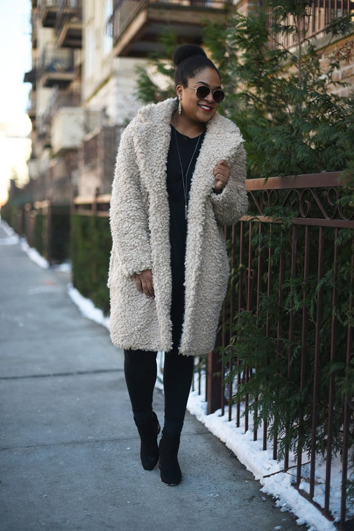Black woman wearing sherpa coat