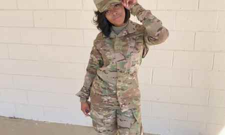 black woman wearing military uniform