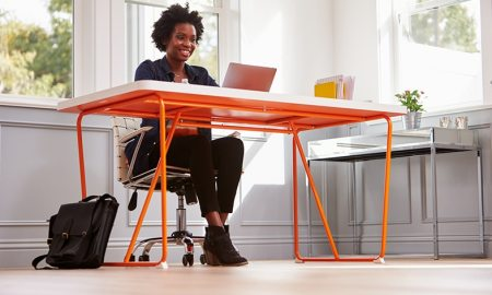 black woman sitting at her desk