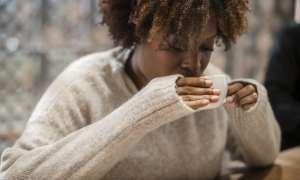 black woman drinking coffee