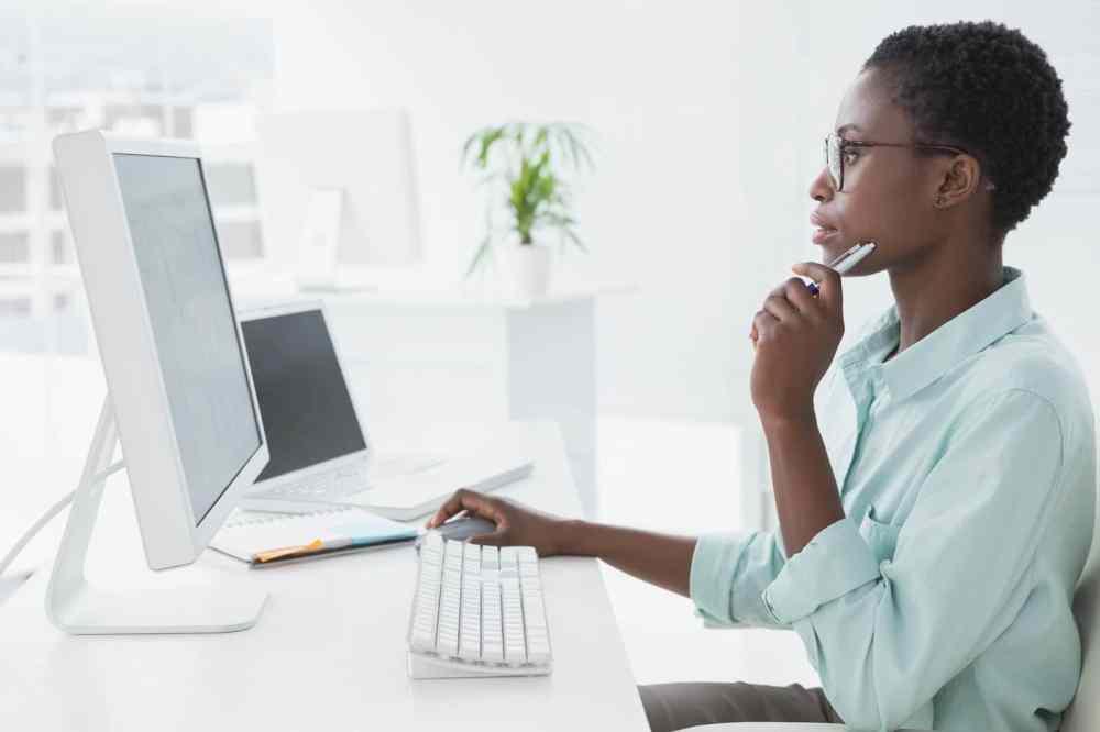 Black woman looking at computer