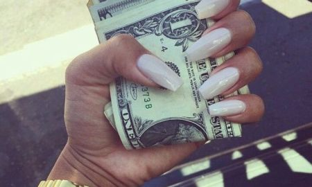black woman holding money in hand