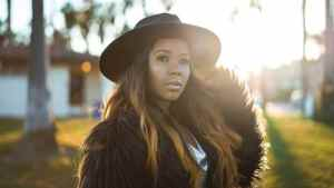 black woman wearing fur coat