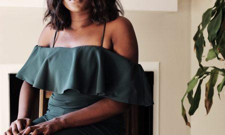 black woman sitting in an office
