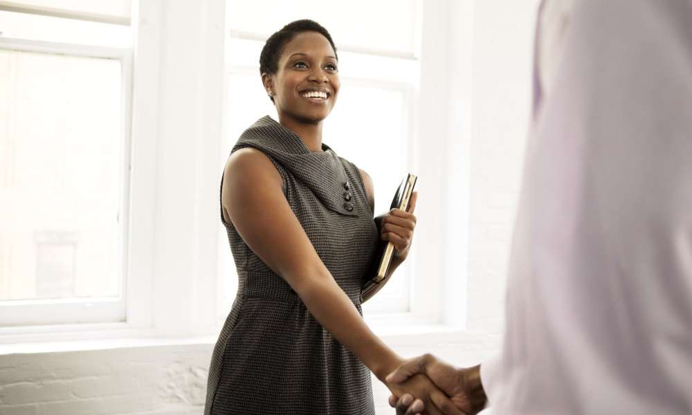 businesswoman shaking hands with investor