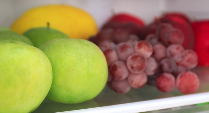 apples and other fruits in the fridge