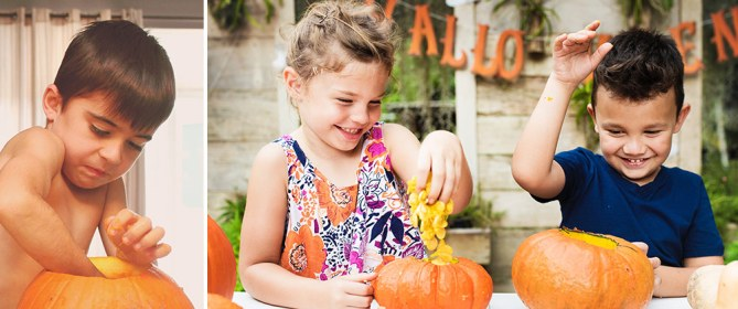 children carving pumpkins