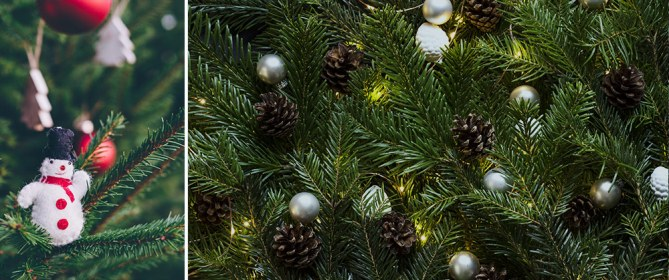 closeup of christmas tree decorated with snowman ornament, pinecones silver balls and lights