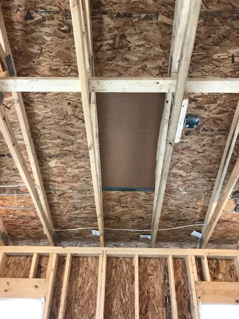 Using Spray Foam for a Country Home - cardboard protection over skylights