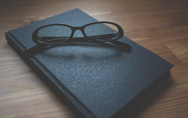 Glasses on top of book
