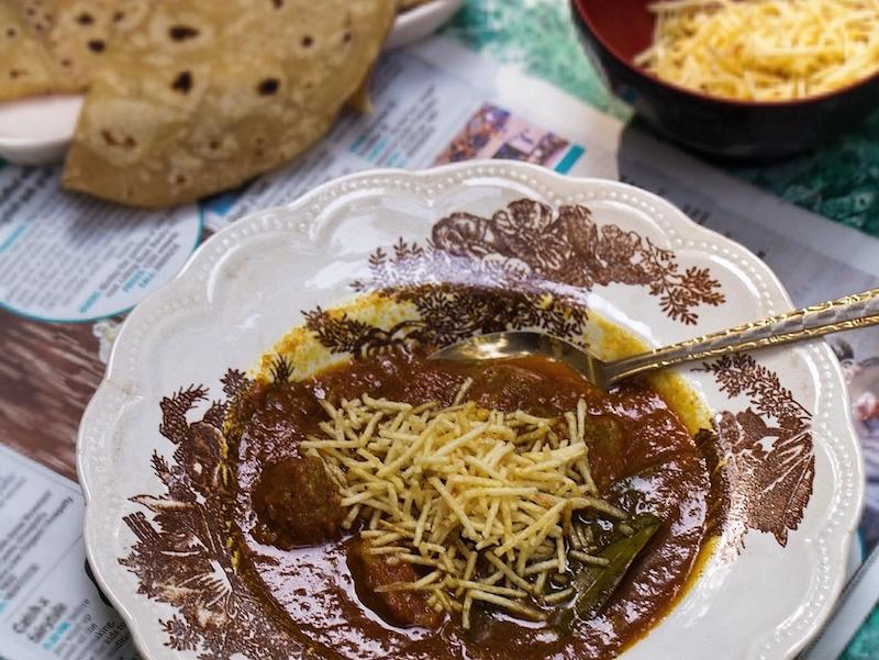 Traditional Parsi Salli Boti - meat with potato sticks