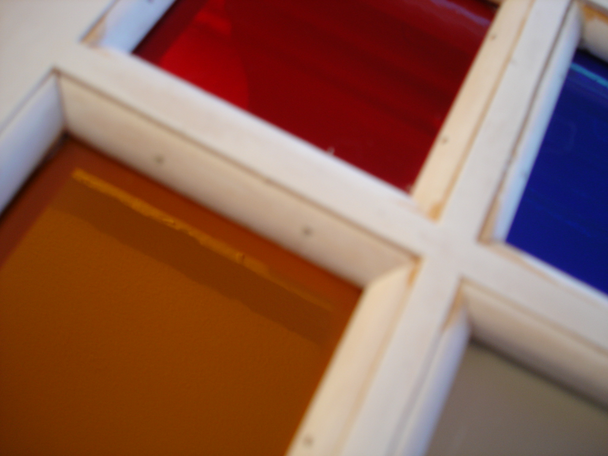 Panes pressed into glazing putty and secured with baton strips
