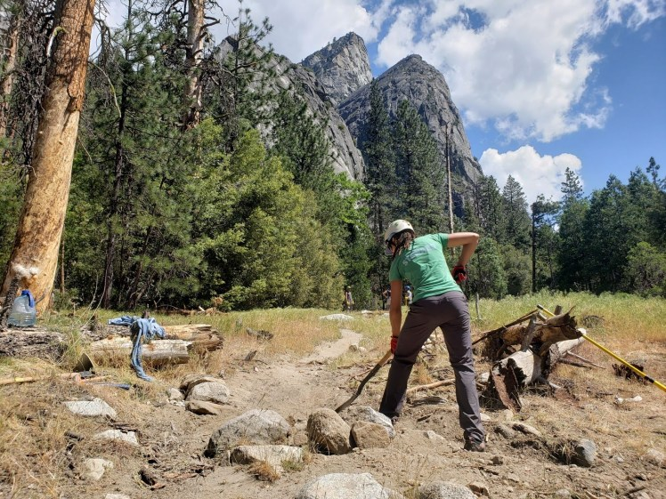 A Bay Area Climbers Coalition steward uses a shovel to repair a trail in Yosemite Valley.