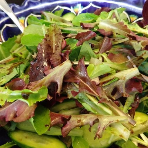 bowl of read and green salad mix