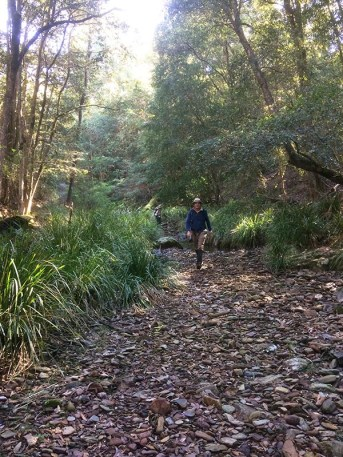 Philip strides out in a wide section of the creek bed