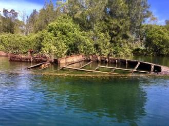 Rusting hulk of granite barge.