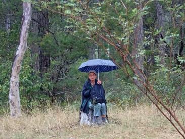 Karen takes shelter to eat lunch.