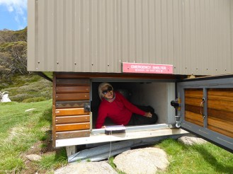 Sharon trying out the Illawong emergency shelter for size.
