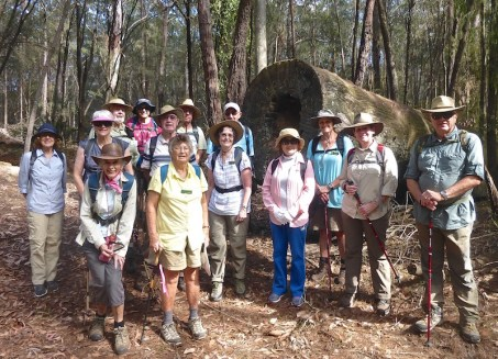 Group in front on the 100yr felled eucalypt
