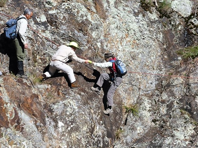 2014 David Sledge hauls Valerie across a sheer rockface into the waiting hands of Michael Beby in Monga National Park