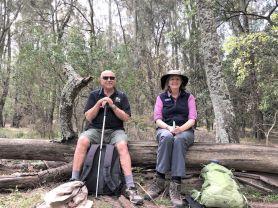 Simeon and Karen take a break on a handy log
